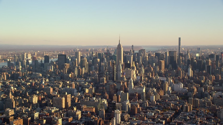 6K stock footage aerial video of a wide view of skyscrapers in Midtown Manhattan at sunrise in New York City Aerial Stock Footage | AX118_171