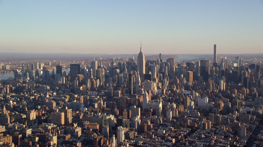 5.5K stock footage aerial video of a wide view of skyscrapers in Midtown Manhattan at sunrise in New York City Aerial Stock Footage | AX118_171E