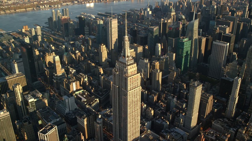 6K stock footage aerial video approach and tilt to the Empire State Building at sunrise in New York City Aerial Stock Footage | AX118_181