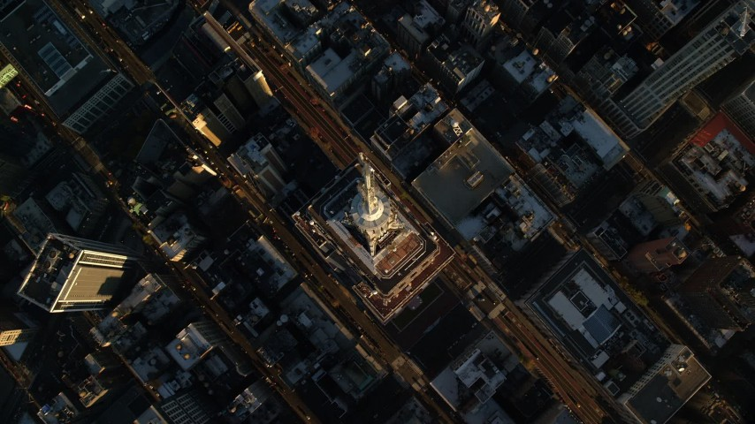 6K stock footage aerial video tilt to bird's eye view of the Empire State Building at sunrise in New York City Aerial Stock Footage | AX118_183