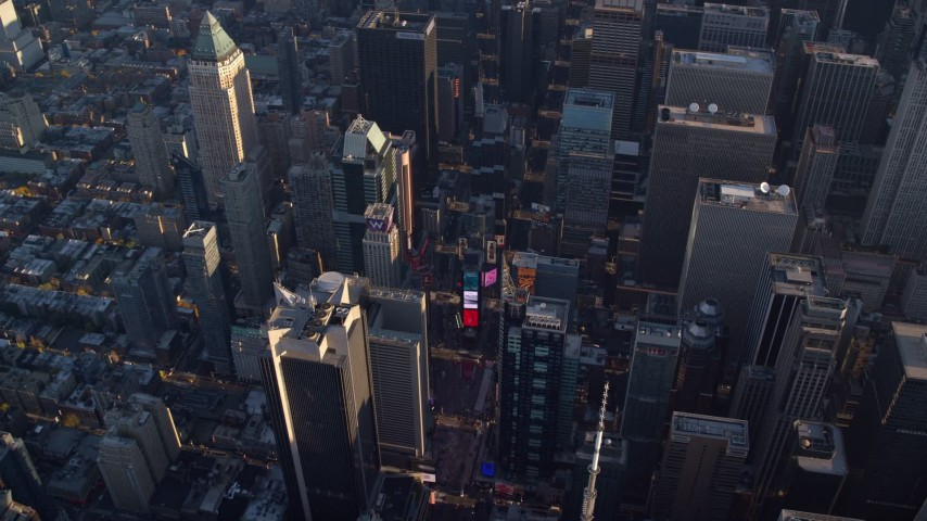 5.5K stock footage aerial video of Times Square at sunrise in New York City Aerial Stock Footage | AX118_184E