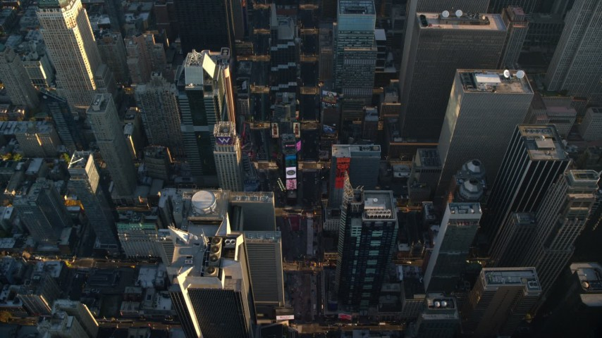 6K stock footage aerial video approach Times Square at sunrise in New York City Aerial Stock Footage | AX118_185