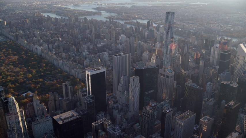 6K stock footage aerial video of 432 Park Avenue in Midtown at sunrise, Manhattan, autumn, New York City Aerial Stock Footage | AX118_187