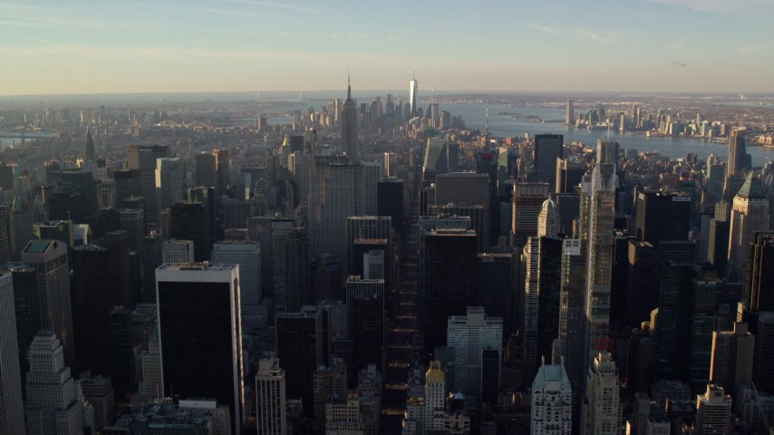 6K stock footage aerial video of Midtown skyscrapers at sunrise in New York City Aerial Stock Footage | AX118_197