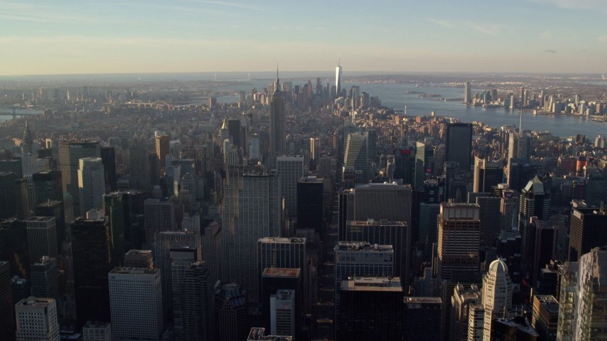 6K aerial video of a wide view of Midtown and Downtown skyscrapers at sunrise in New York City Aerial Stock Footage | AX118_198