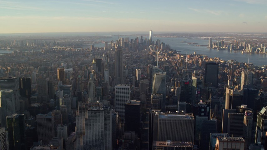 6K stock footage aerial video of a wide view of Midtown and Downtown skyscrapers at sunrise in New York City Aerial Stock Footage | AX118_199