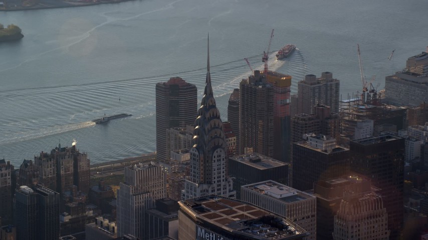 5.5K stock footage aerial video of orbiting the Chrysler Building at sunrise in New York City Aerial Stock Footage | AX118_201E