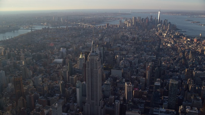 6K stock footage aerial video of a wide view of Manhattan, from Empire State Building to Downtown at sunrise in New York City Aerial Stock Footage | AX118_203
