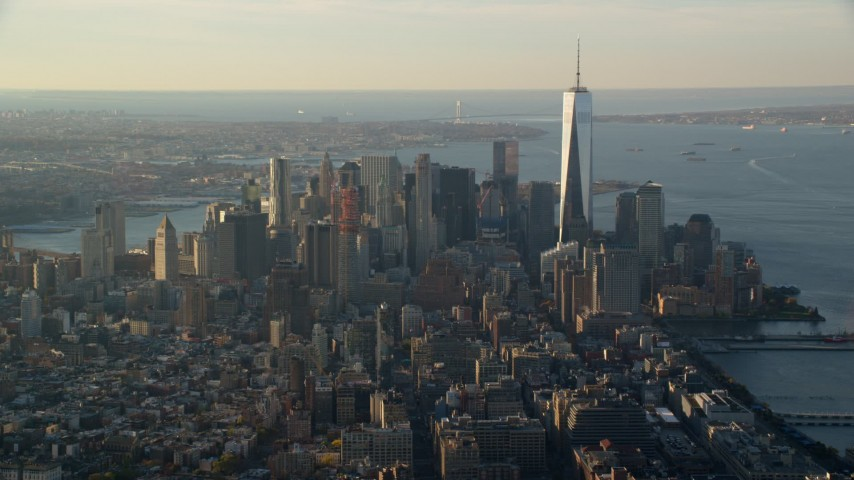 6K stock footage aerial video of skyscrapers in Lower Manhattan at sunrise in New York City Aerial Stock Footage | AX118_206