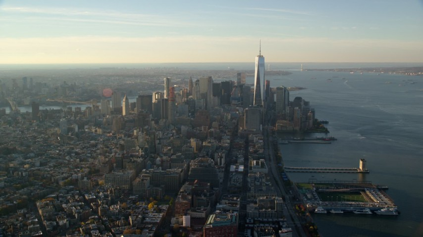 6K stock footage aerial video of a wide view of Freedom tower and Lower Manhattan at sunrise in New York City Aerial Stock Footage | AX118_208