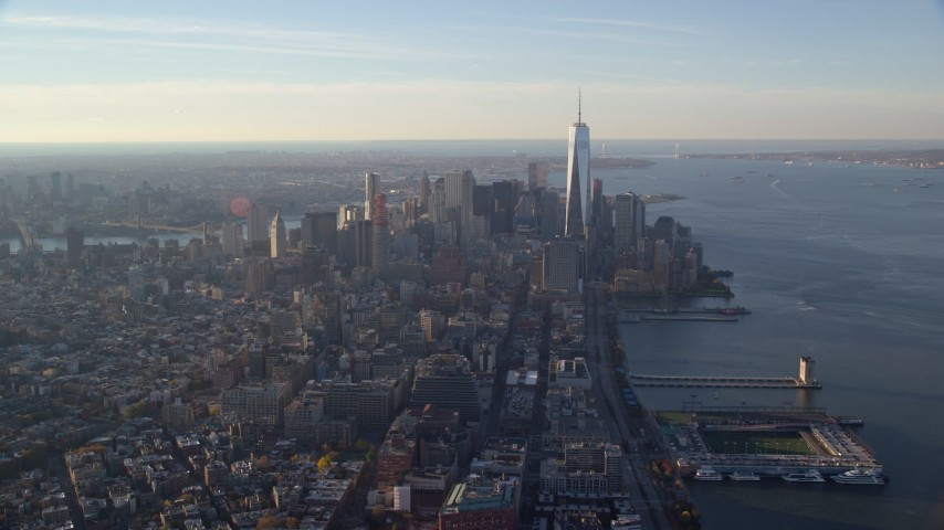 5.5K stock footage aerial video of a wide view of Freedom Tower and Lower Manhattan at sunrise in New York City Aerial Stock Footage | AX118_208E