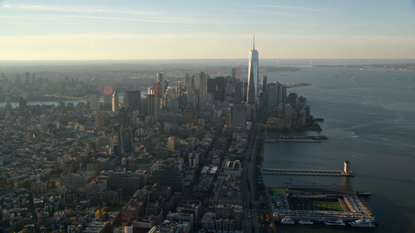 6K stock footage aerial video of Lower Manhattan skyscrapers at sunrise in New York City Aerial Stock Footage | AX118_209