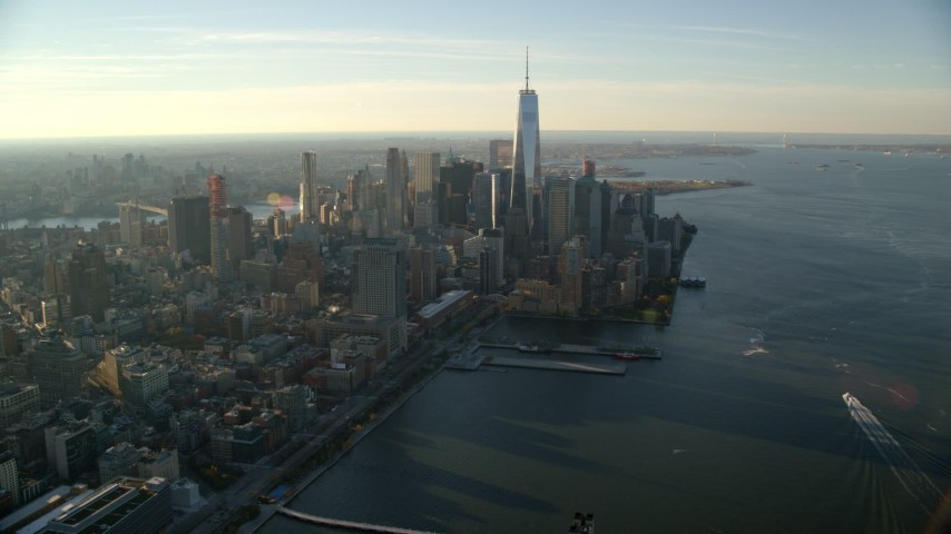 6K stock footage aerial video of a wide view of Lower Manhattan's skyscrapers at sunrise in New York City Aerial Stock Footage | AX118_211