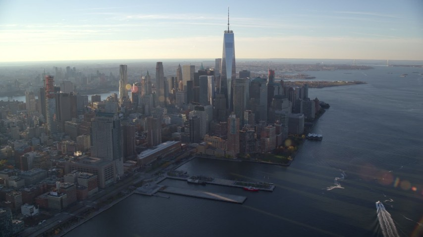 5.5K stock footage aerial video of a wide view of Lower Manhattan's skyscrapers at sunrise in New York City Aerial Stock Footage | AX118_211E