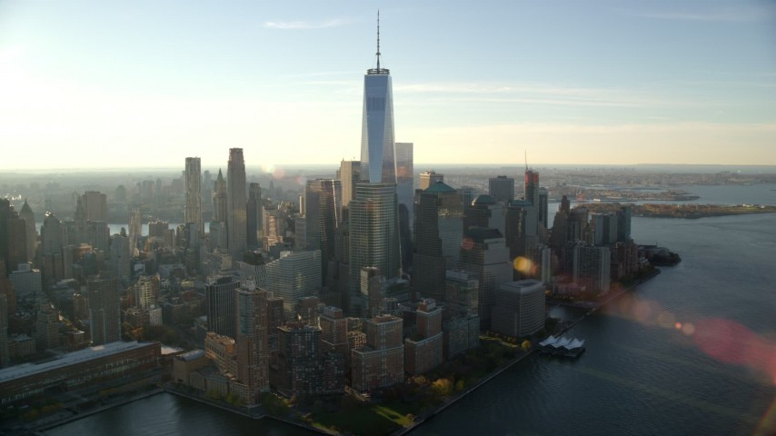 6K stock footage aerial video of the World Trade Center's skyscrapers at sunrise in New York City Aerial Stock Footage | AX118_213