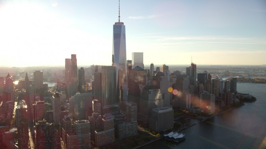 6K stock footage aerial video of orbiting towering World Trade Center skyscrapers at sunrise in New York City Aerial Stock Footage | AX118_214