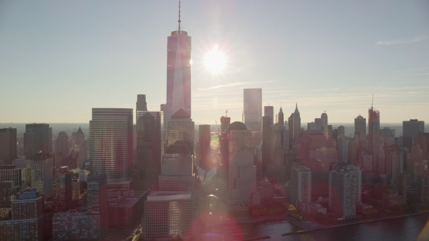 6K stock footage aerial video of Freedom Tower and World Trade Center skyscrapers at sunrise in New York City Aerial Stock Footage | AX118_215