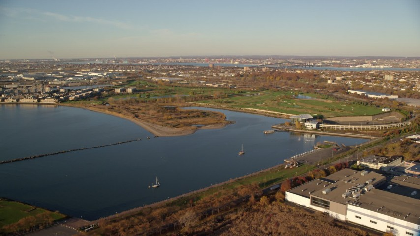 6K aerial video of Waterfront Golf Course at sunrise in Jersey City, New Jersey Aerial Stock Footage | AX118_218