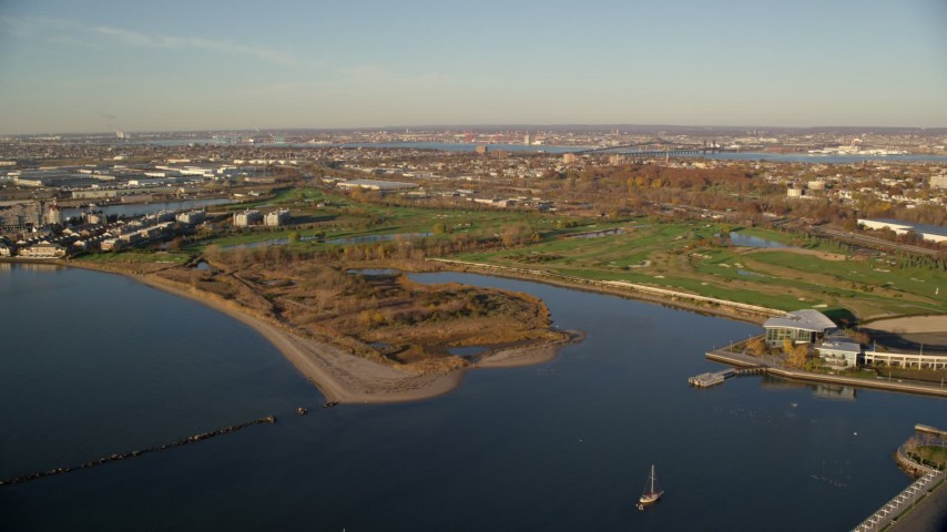 6K stock footage aerial video of approaching Waterfront Golf Course at sunrise in Jersey City, New Jersey Aerial Stock Footage | AX118_219
