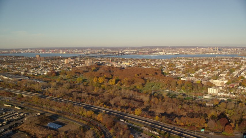 6K stock footage aerial video of approaching a cemetery at sunrise in Jersey City, New Jersey Aerial Stock Footage   AX118_221