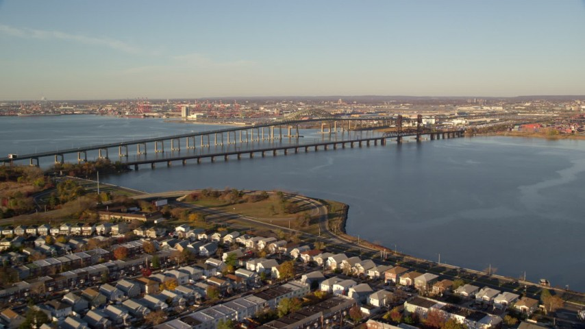 6K stock footage aerial video of Newark Bay Bridge and Lehigh Valley Bridge at sunrise in Newark, New Jersey Aerial Stock Footage | AX118_223