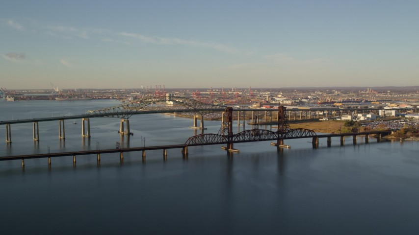 6K stock footage aerial video of an orbit of the Newark Bay Bridge and Lehigh Valley Bridge at sunrise in Newark, New Jersey Aerial Stock Footage | AX118_225