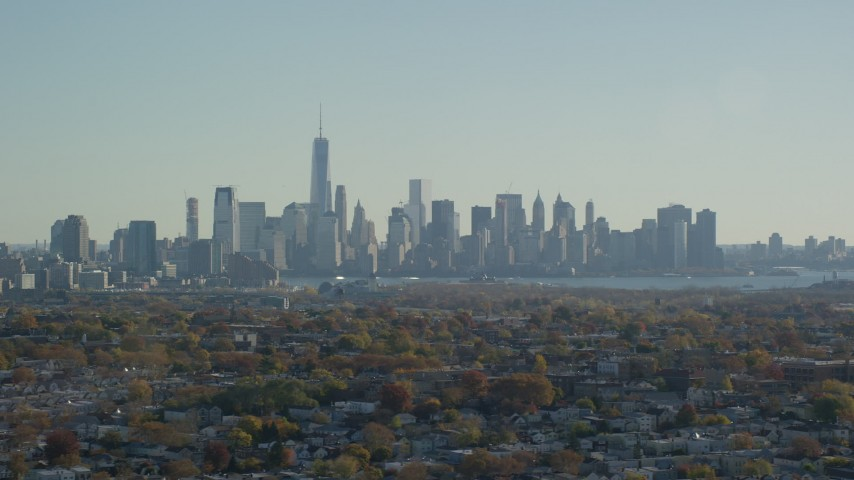 6K stock footage aerial video of the skyline of Lower Manhattan in Autumn, New York City Aerial Stock Footage | AX119_004