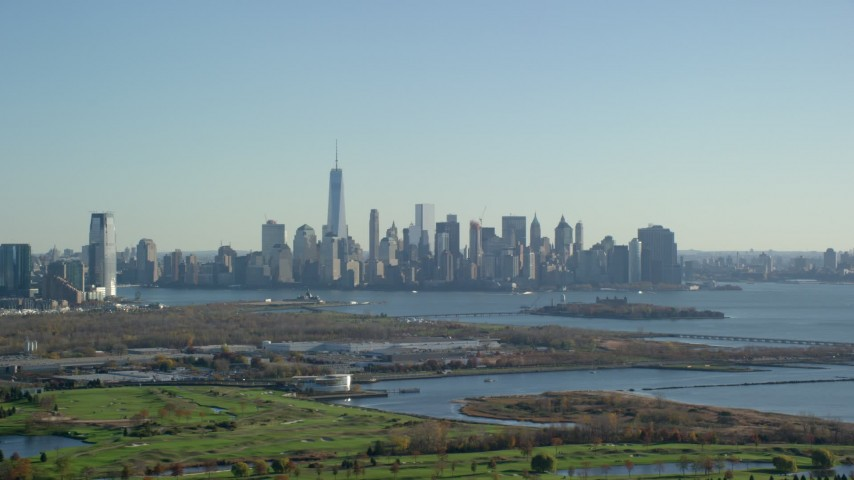 5.5K stock footage aerial video of the towering skyline of Lower Manhattan in Autumn, New York City Aerial Stock Footage   AX119_005E