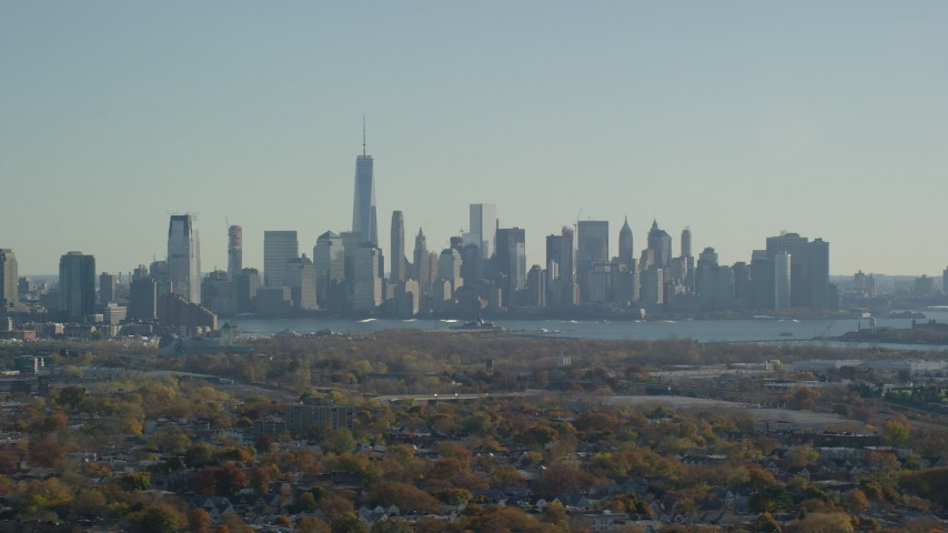 6K stock footage aerial video of a wide view of the skyline of Lower Manhattan in Autumn, New York City Aerial Stock Footage | AX119_006