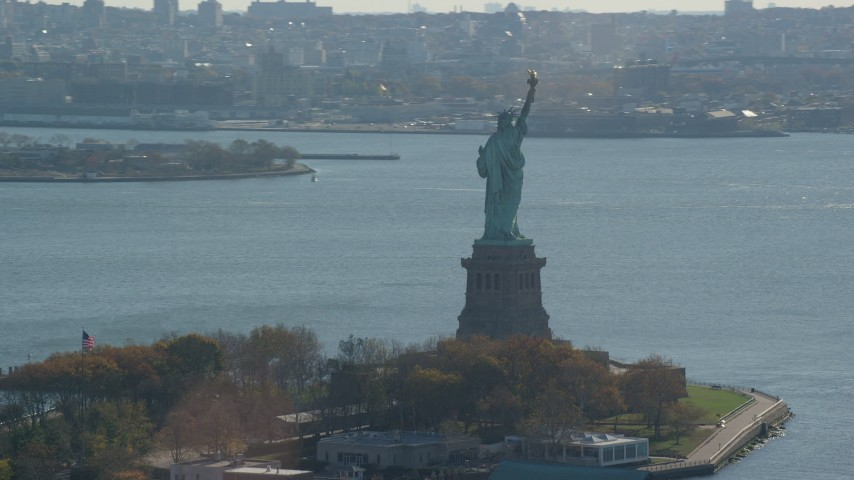 6K stock footage aerial video of an orbit around the back of the Statue of Liberty in Autumn, New York Aerial Stock Footage | AX119_011