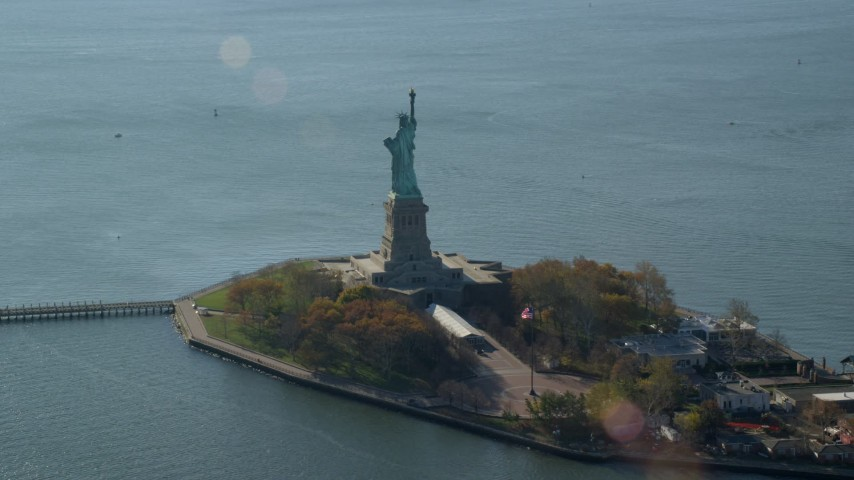 6K stock footage aerial video of orbiting the side of the Statue of Liberty in Autumn, New York Aerial Stock Footage | AX119_013