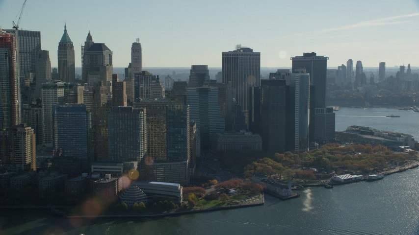 6K stock footage aerial video of an orbit of Battery Park and skyscrapers in Autumn, Lower Manhattan, New York City Aerial Stock Footage | AX119_016