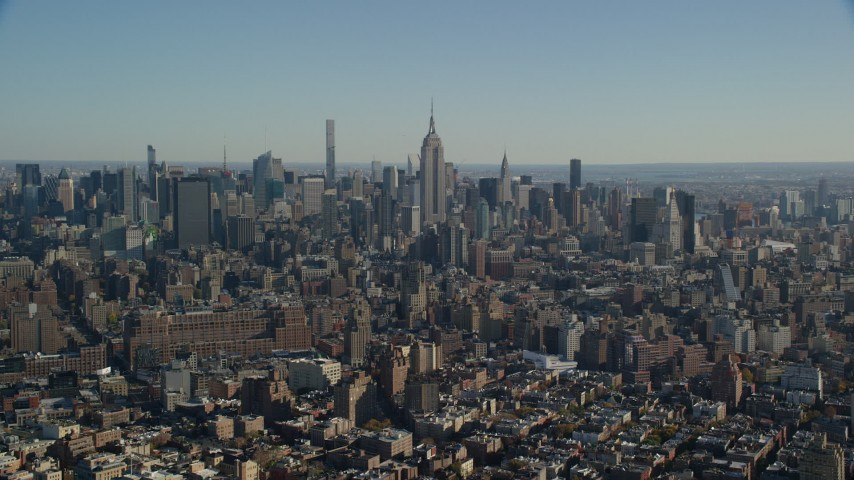 6K stock footage aerial video of the Empire State Building and skyscrapers in Midtown, New York City Aerial Stock Footage | AX119_021