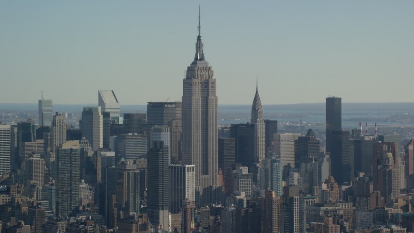 6K stock footage aerial video of the famous Empire State Building in Midtown, New York City Aerial Stock Footage | AX119_022