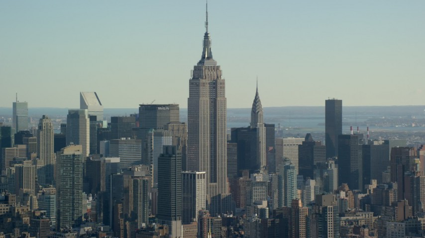5.5K stock footage aerial video of the famous Empire State Building in Midtown, New York City Aerial Stock Footage   AX119_022E