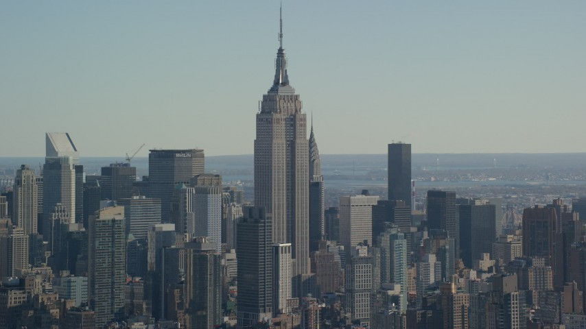 6K aerial video of a wide orbit of the Empire State Building in Midtown, New York City Aerial Stock Footage   AX119_023
