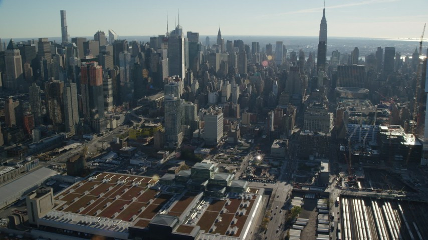 6K stock footage aerial video of the convention center and West Side Yard in Hell's Kitchen in Midtown, New York City Aerial Stock Footage | AX119_027