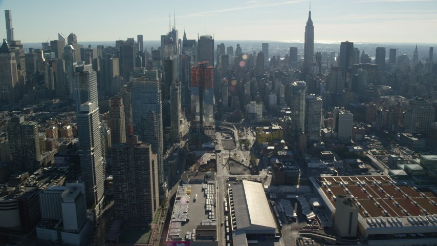 6K stock footage aerial video flyby convention center and skyscrapers in Hell's Kitchen in Midtown, New York City Aerial Stock Footage | AX119_028