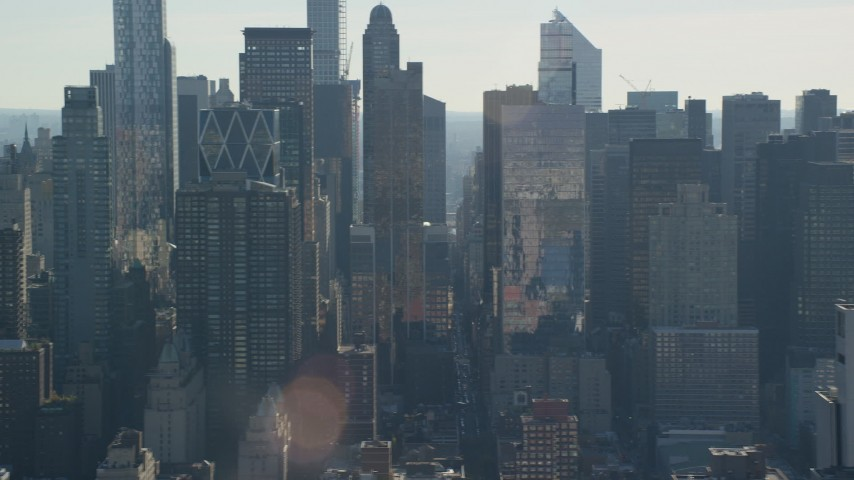6K stock footage aerial video of flying by skyscrapers in Hell's Kitchen in Midtown, New York City Aerial Stock Footage | AX119_030