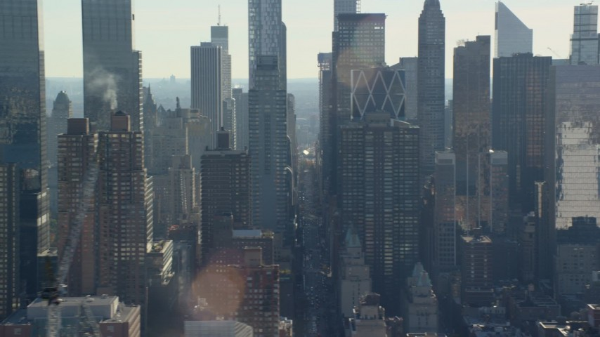 5.5K stock footage aerial video of flying by skyscrapers in Hell's Kitchen in Midtown, New York City Aerial Stock Footage | AX119_030E