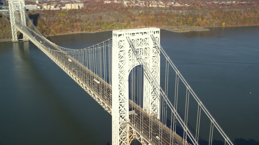 5.5K stock footage aerial video of an approach to the George Washington Bridge in Autumn, New York City Aerial Stock Footage | AX119_044E
