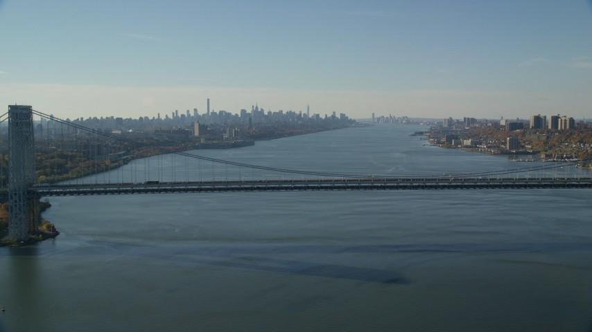 6K stock footage aerial video of George Washington Bridge and Midtown skyline in Autumn, New York City Aerial Stock Footage | AX119_047