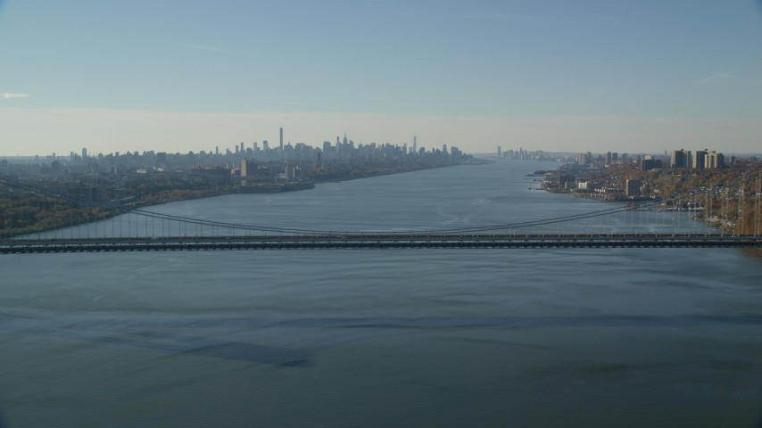 6K stock footage aerial video of the Midtown skyline seen from George Washington Bridge in Autumn, New York City Aerial Stock Footage | AX119_048