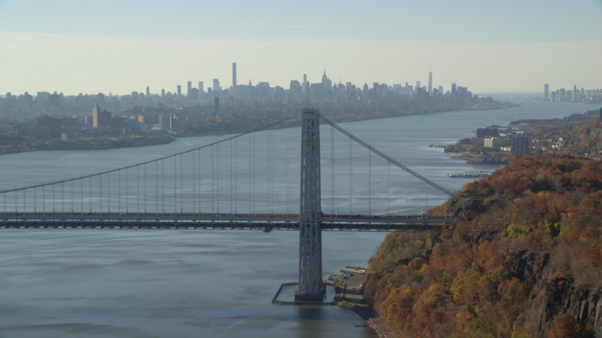 5.5K stock footage aerial video of the Midtown skyline, flyby George Washington Bridge in Autumn, New York City Aerial Stock Footage | AX119_050