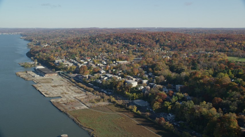 6K aerial stock footage video of riverfront homes in Hastings on Hudson, New York, in Autumn Aerial Stock Footage | AX119_074