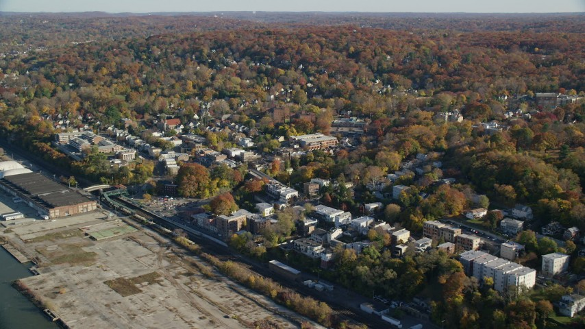6K stock footage aerial video of flying by riverfront town of Hastings on Hudson, New York, in Autumn Aerial Stock Footage | AX119_075