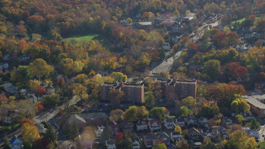 6K stock footage aerial video orbiting small town of Hastings on Hudson, New York, in Autumn Aerial Stock Footage | AX119_077