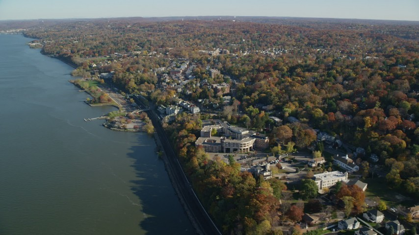 6K aerial stock footage video of passing the waterfront town of Dobbs Ferry, New York, in Autumn Aerial Stock Footage AX119_078 | Axiom Images