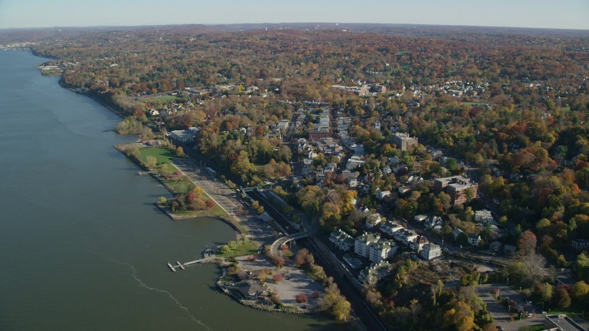 6K stock footage aerial video of a the waterfront town of Dobbs Ferry in Autumn, New York Aerial Stock Footage | AX119_079
