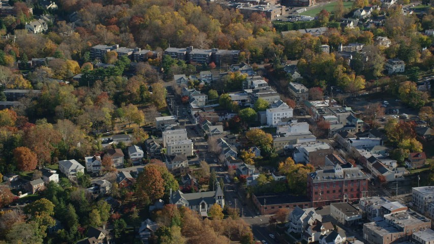 6K stock footage aerial video of small town shops in Dobbs Ferry in Autumn, New York Aerial Stock Footage | AX119_080